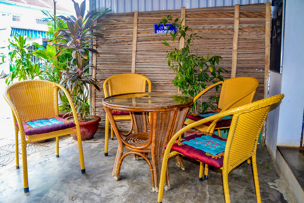 Karma Waters Hoi An vegetarian restaurant chairs and table