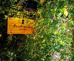 Sign and folliage of The Secret Garden