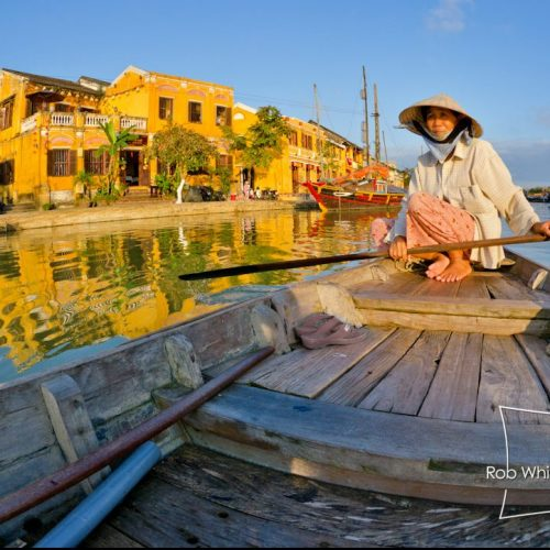 Woman in Conical Hat Rowing on Thu Bon River, Hoi An, Vietnam
