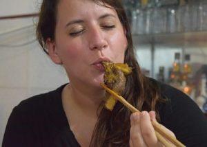 Woman kiss chicken head, weird food, Hoi An