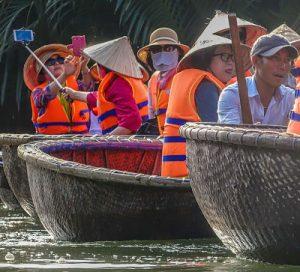 Hoi An Coconut Palms. Hoi An Kayak Tours. Korean tourists in bamboo basket boats.