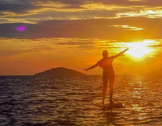 Sunrise with SUP Monkey , lone girl arms outstretched_opt
