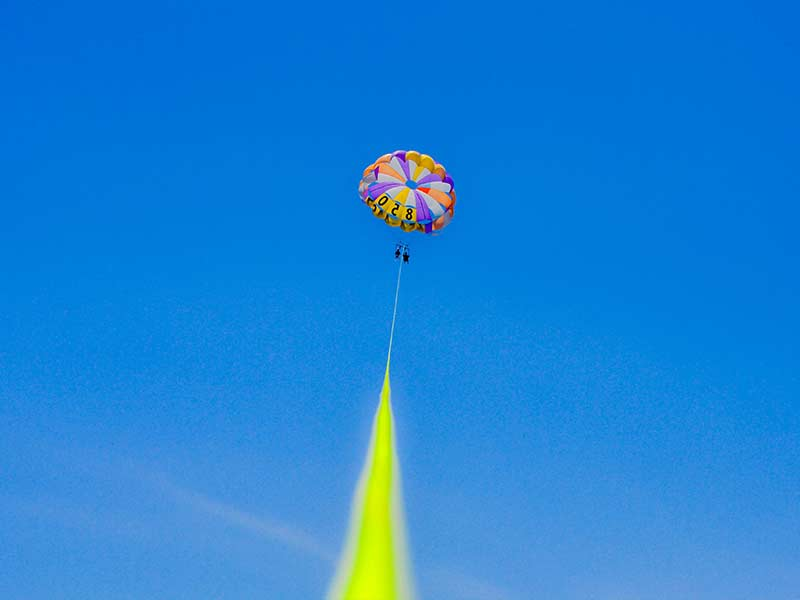 Hoi An with kids; parasailing in the sky