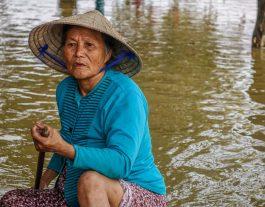 Floods in Hoi An: 2016. Hoi An's Rainy Season. Woman rowing