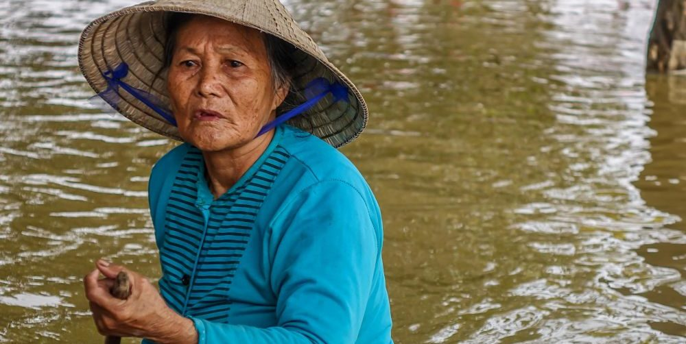 Rainy Season. Floods in Hoi An: 2016. Hoi An's Rainy Season. Woman rowing