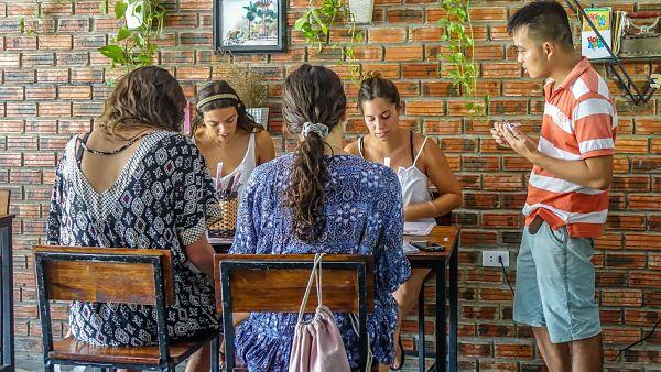 Nhan's Kichen. Nhan explaining the menu 1