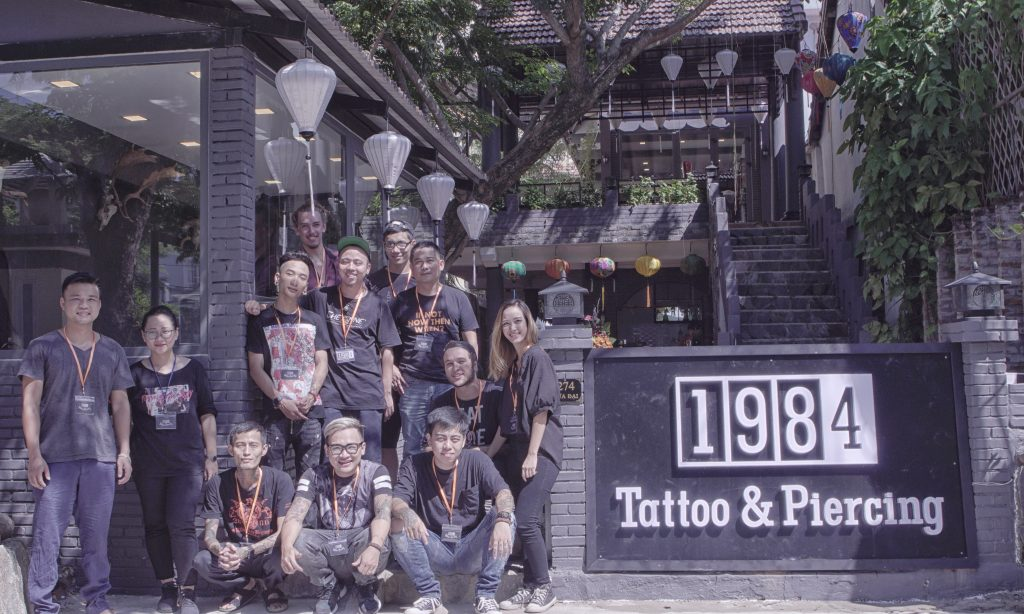 1984 Tattoo & Piercing Hoi An staff and building